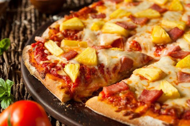 Pineapple and Ham Hawaiian Pizza on a platter.