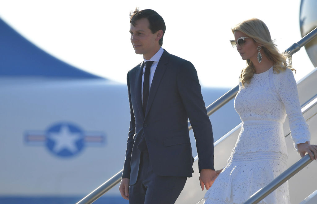 Ivanka Trump and Jared Kushner leave a plane