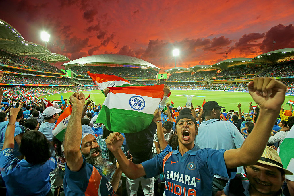 Indian fans celebrate at a cricket match.