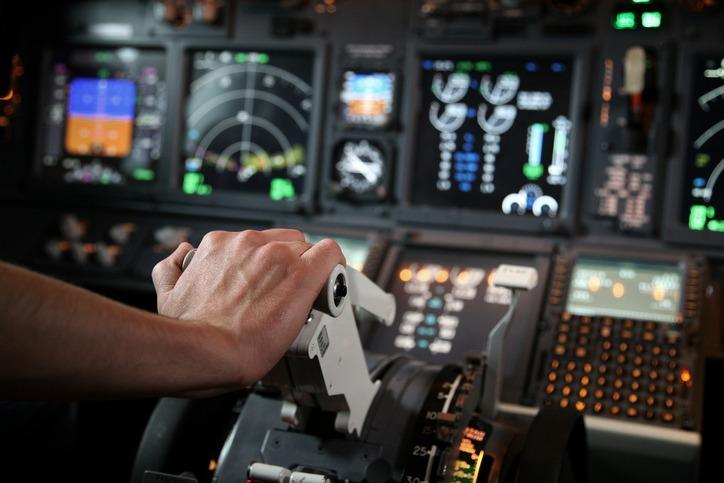 Flight simulator with pilot hand in throttle