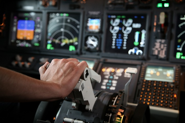 Flight simulator with pilot hand in throttle
