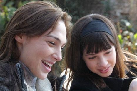 Gal Gadot and Nitzan Levratovsky in Kathmandu laughing and looking at something off screen