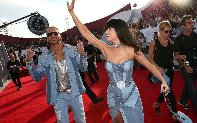 Katy Perry and Riff Raff are in denim matching outfits on the red carpet.