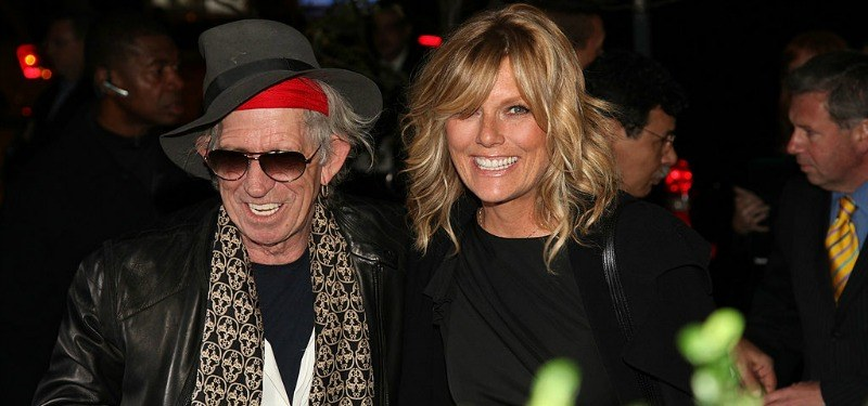 Keith Richards and Patty Hansen are smiling together.