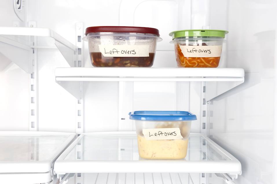Leftover containers of food in a refrigerator