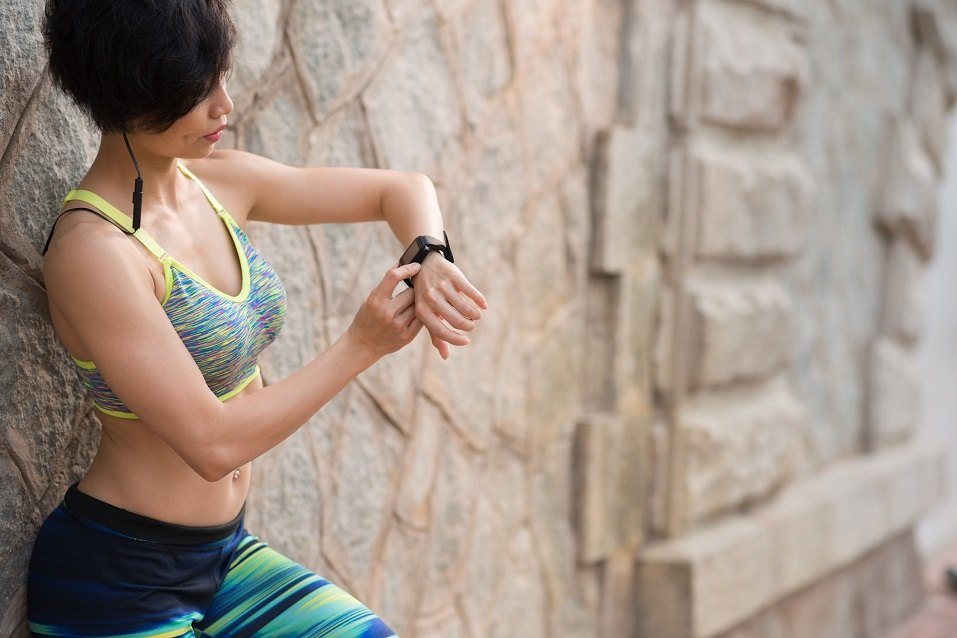 Woman checking activity tracker
