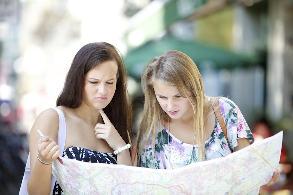 Lost tourists with map