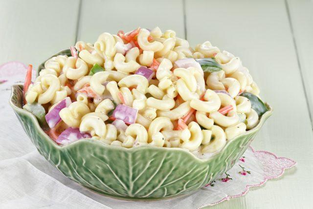 Macaroni salad with mayonnaise and vegetables.