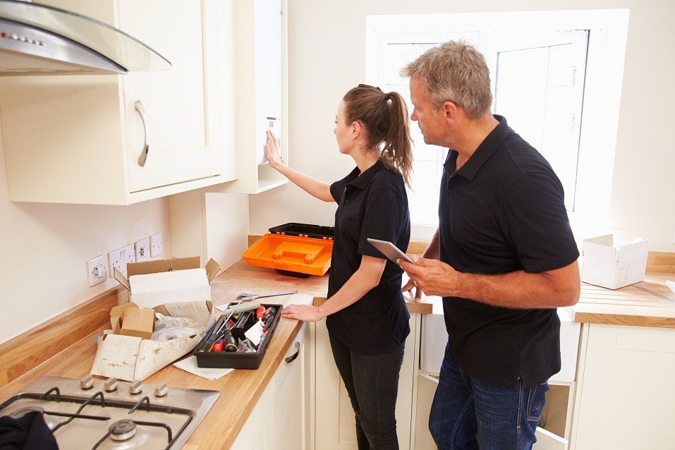 Man and woman working on a new kitchen