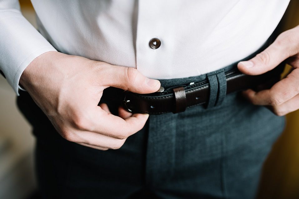 Man corrects belt