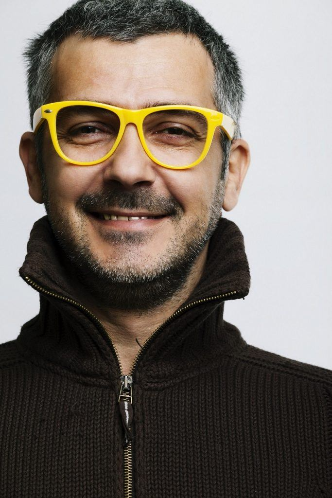 man wearing yellow glasses
