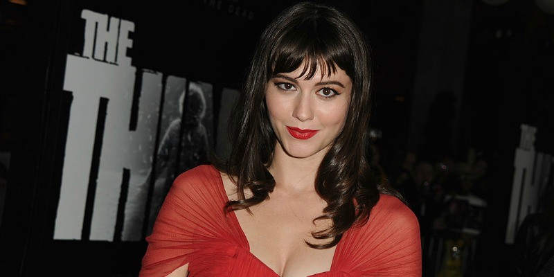 Mary Elizabeth Winstead is smiling in a red dress.