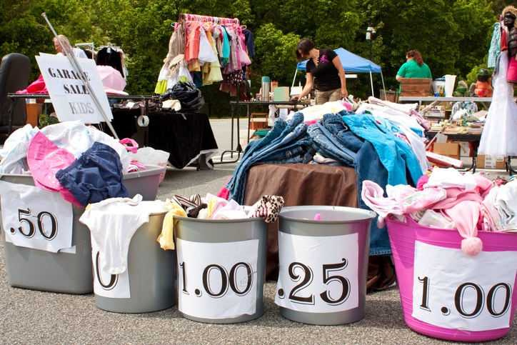 Merchandise Labeled With Prices On Display At Garage Sale