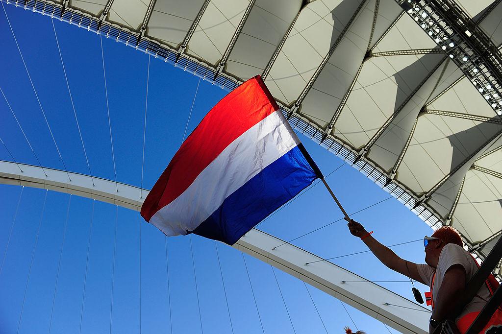 A Netherlands fan waves a flag