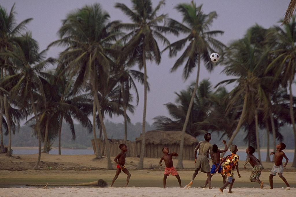 Kids playing beach football in Nigeria