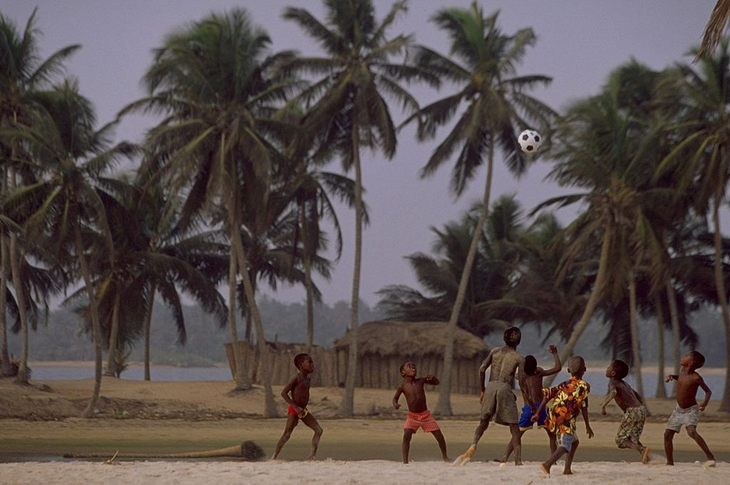 Kids playing beach football in Nigeria