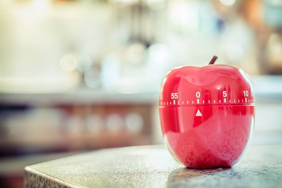 red kitchen timer shaped like apple