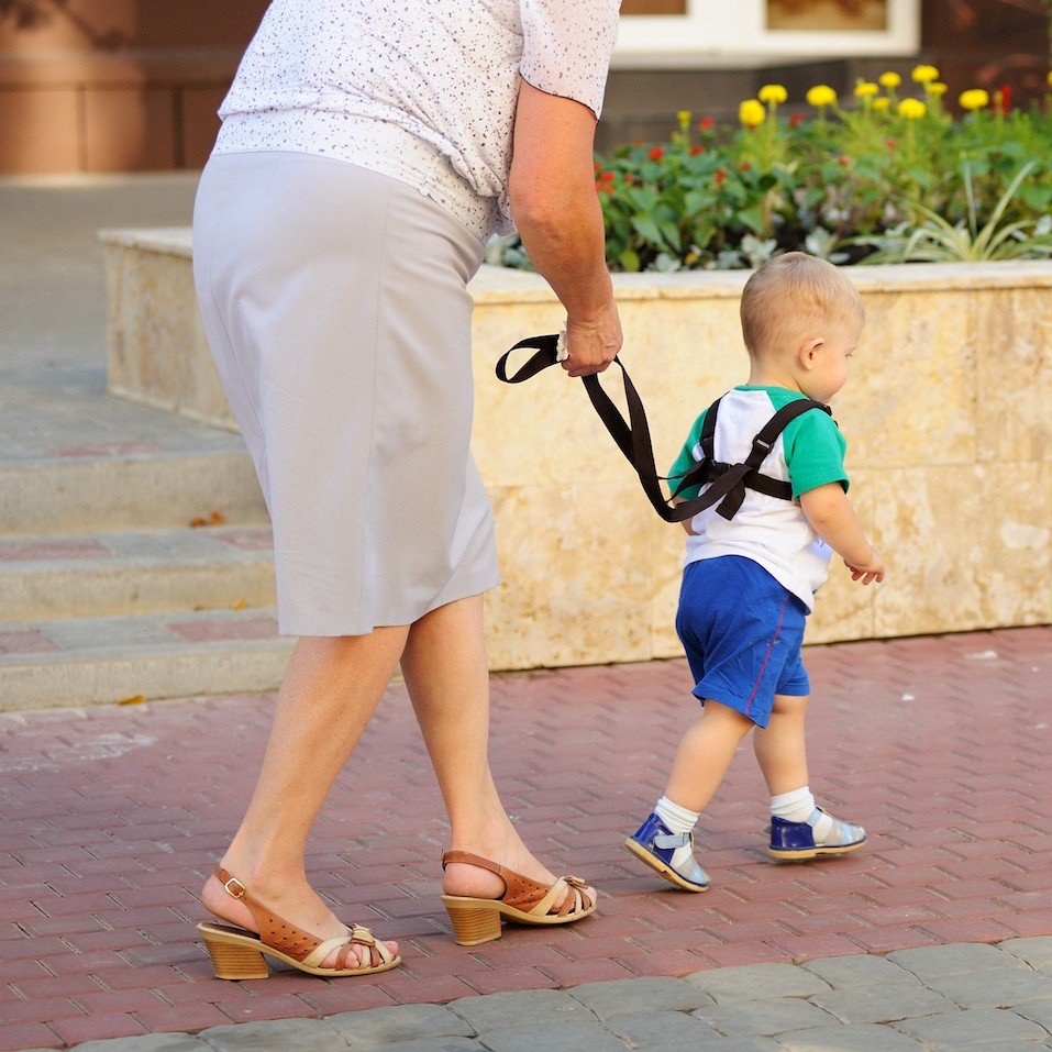 Woman walking with toddler