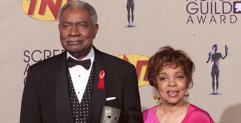 Ossie Davis and Ruby Dee pose together on the red carpet.