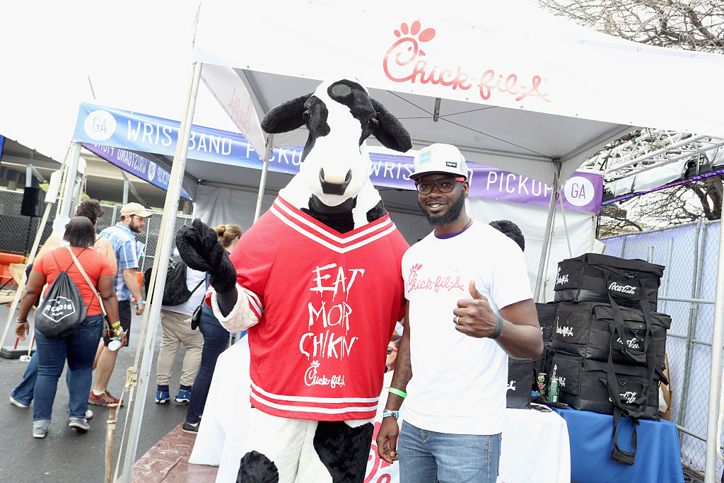 Chick-fil-A cow and brand ambassador attend the PANDORA Discovery Den SXSW