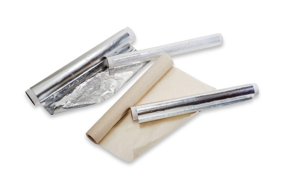 rolls of plastic wrap, aluminum foil and parchment paper