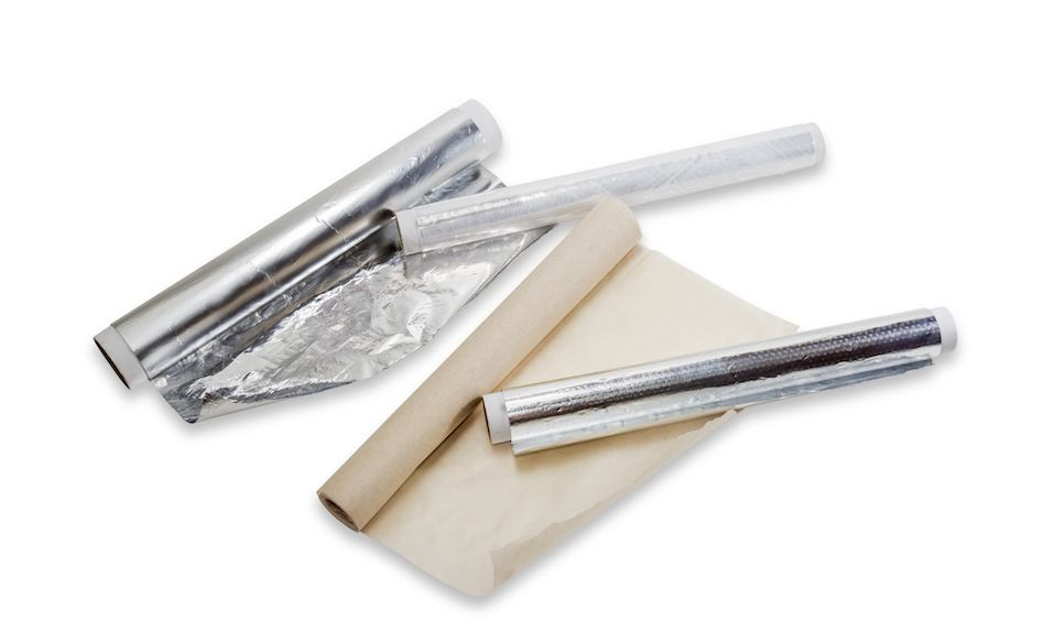 rolls of plastic wrap, aluminum foil and parchment paper