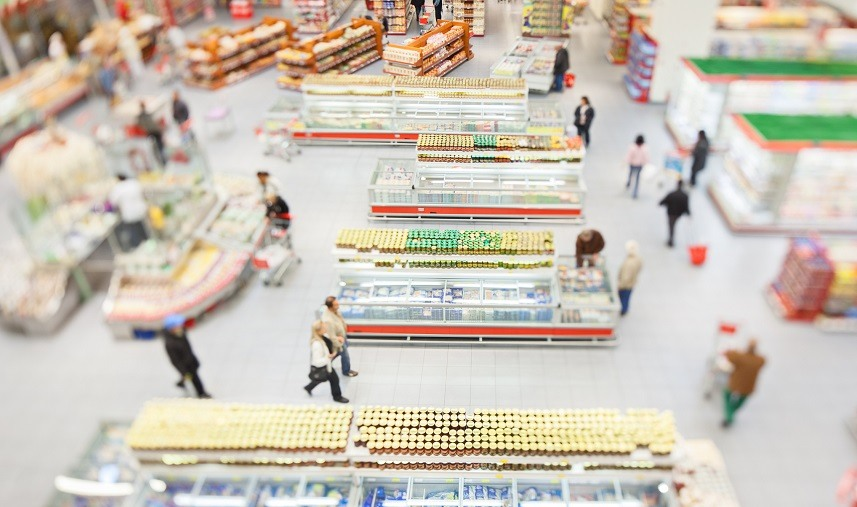 People shopping in a large supermarket