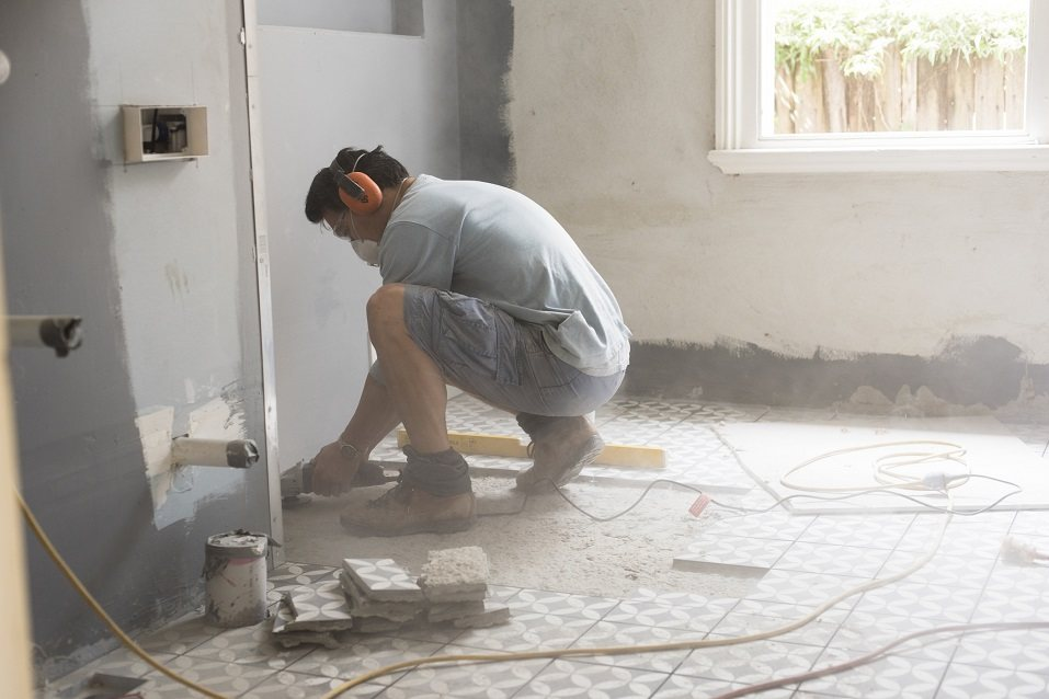Grinding the bathroom floor during a bathroom remodel