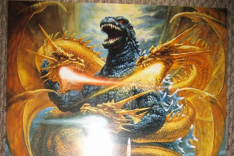 King Ghidorah, with his three heads all blowing a stream of flames directly at Godzilla's chest