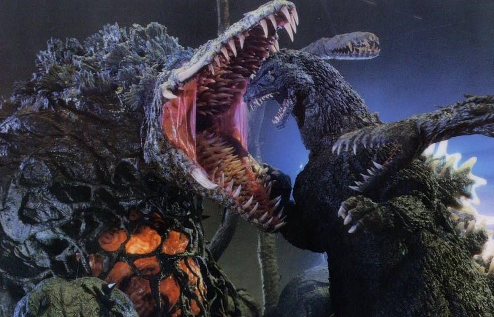Biollante with his jaw wide open, about to clench down on Godzilla's head