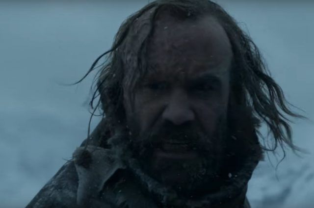 Sandor Clegane in the snow, turning to look over his right shoulder.