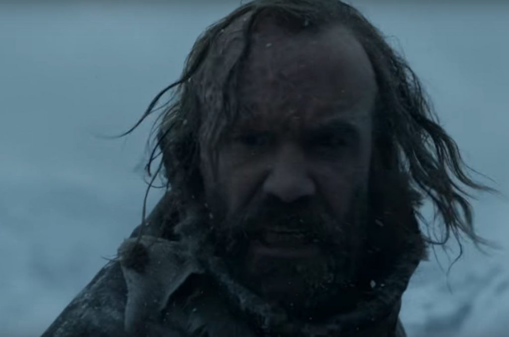 Sandor Clegane in the snow, turning to look over his right shoulder