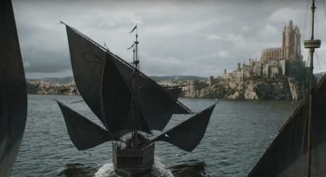 Ships sailing toward a castle on a hill at King's Landing.