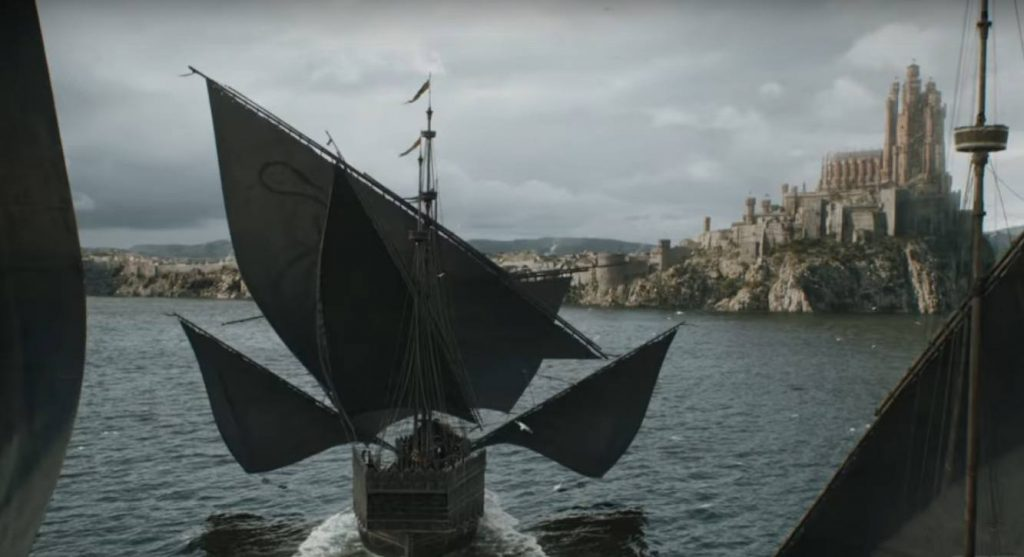 Ships sailing toward a castle on a hill at King's Landing