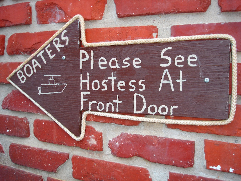 """Sign that says """"boaters, please see hostess at front door"""""""