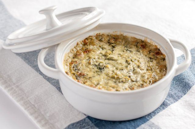 Spinach and artichoke dip is creamy, which signals it's more fattening.