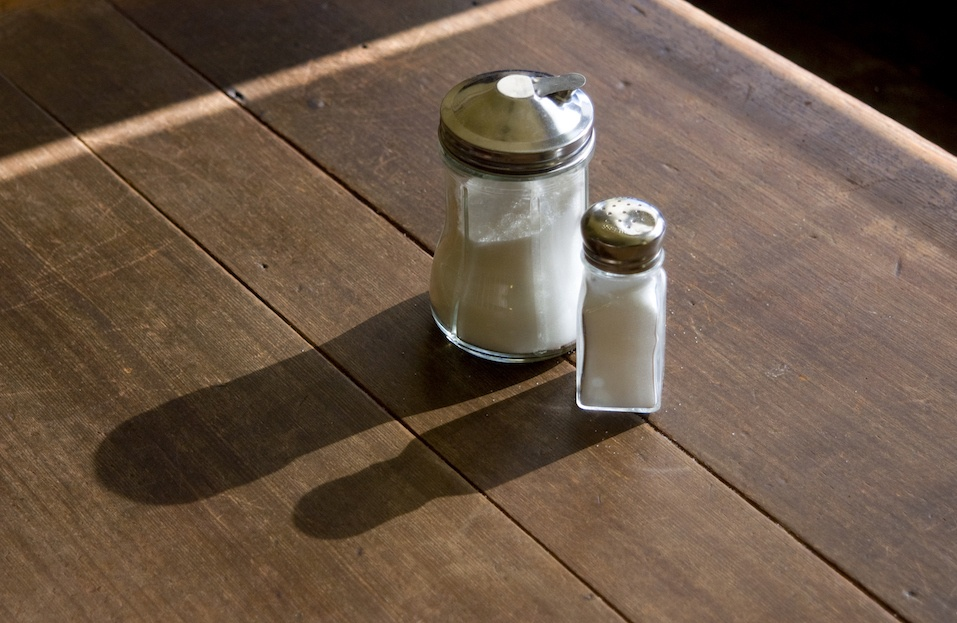 Centered on the table are a sugar and salt shaker