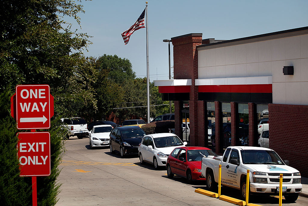 Drive through customers wait in line at a Chick-fil-A resturant