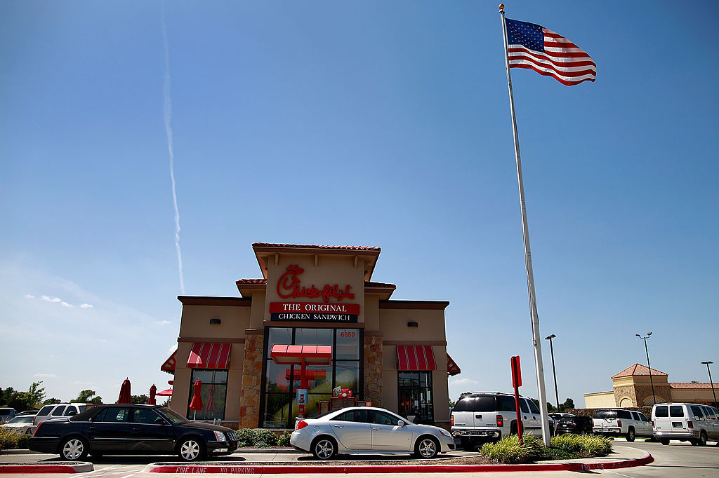 Drive through customers wait in line at a Chick-fil-A restaurant