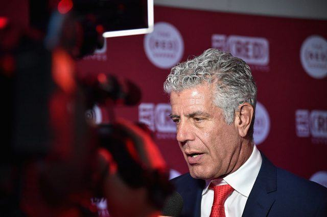 Anthony Bourdain being interviewed on a red carpet.