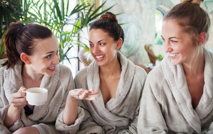 Three young women drinking tea at spa resort