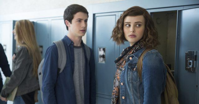 Hannah and Clay talk to each other in front of school lockers in '13 Reasons Why'.