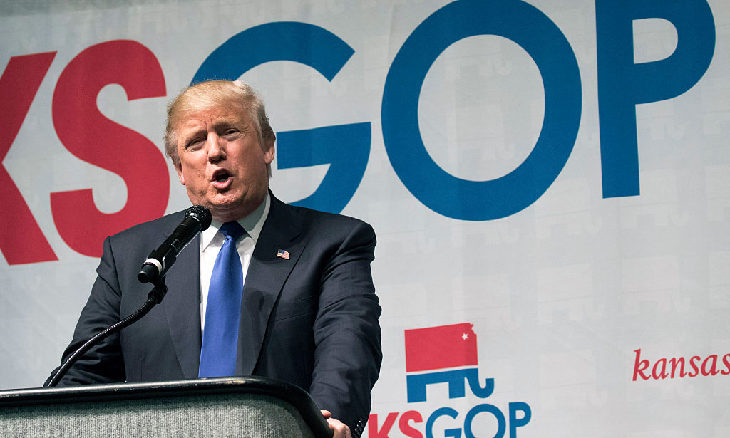 Trump makes a speech at a campaign rally in Kansas