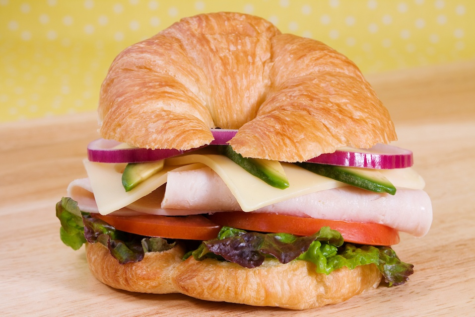 Turkey Croissant Sandwich on a wooden table