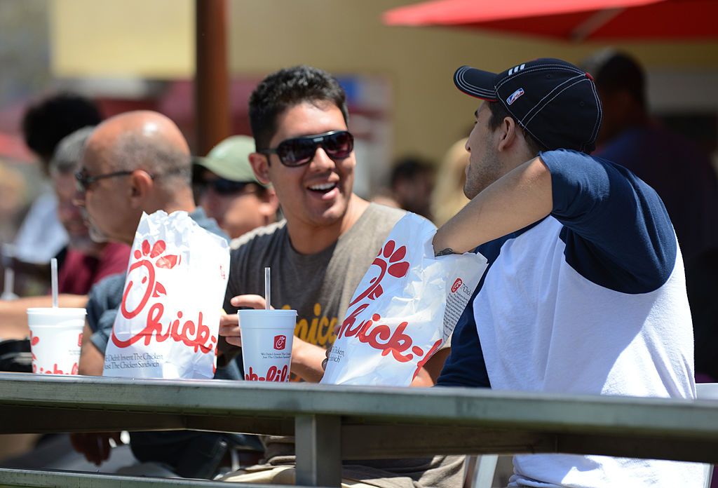 Two men prepare to have lunch on the patio of the Chick-fil-A in Hollywood, California