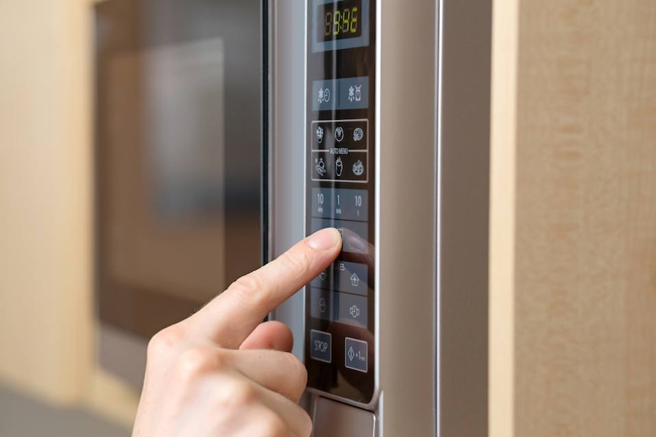 Detail of hand while using the microwave