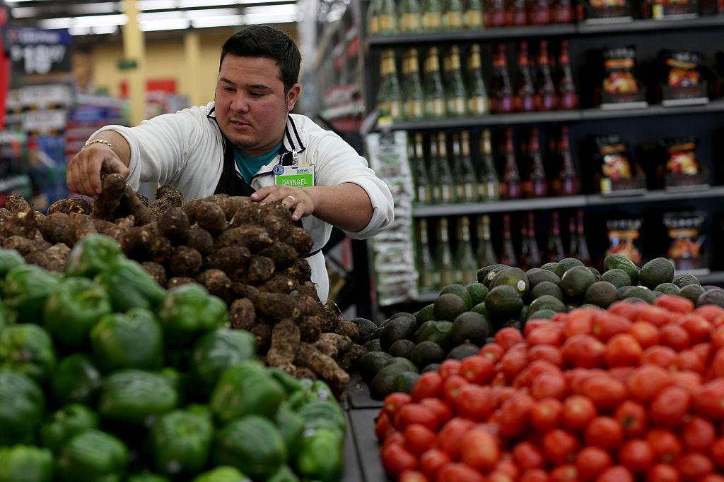 man stocking produce