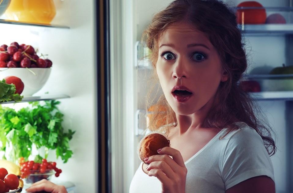 woman eats sweets at night