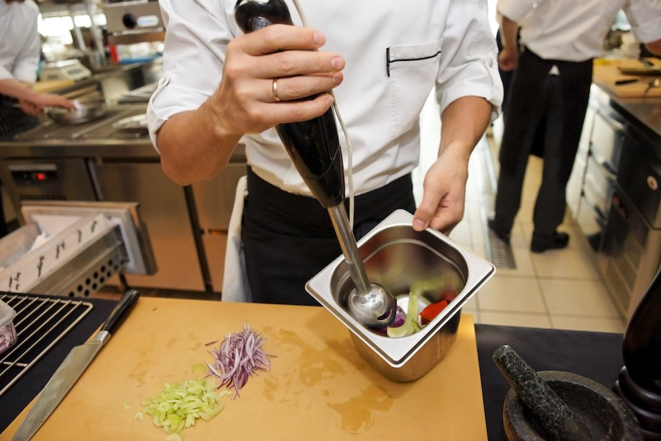 chef using immersion blender