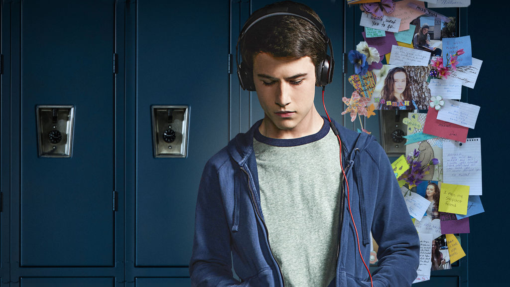 Clay listens to headphones in front of school lockers in 13 Reasons Why
